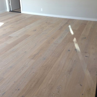 Example of a large transitional light wood floor bedroom design in San Francisco with gray walls