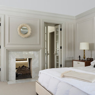 Transitional master bedroom in Minneapolis with beige walls, carpet and a two-sided fireplace.