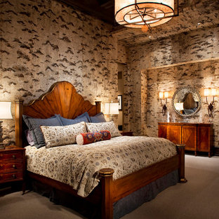 Inspiration for a rustic carpeted bedroom remodel in Other with multicolored walls