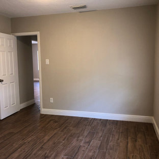 Small arts and crafts master bedroom in Orlando with beige walls, ceramic floors and brown floor.