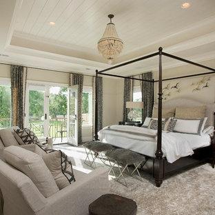 Bedroom - beach style dark wood floor and brown floor bedroom idea with beige walls