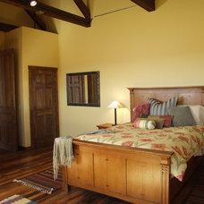 Mediterranean Bedroom by Legends West Reclaimed Lumber