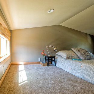 This is an example of a small arts and crafts loft-style bedroom in Seattle with grey walls, carpet and no fireplace.