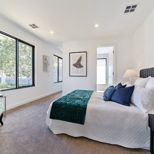 Mid-sized contemporary master bedroom in Melbourne with white walls, carpet and grey floor.