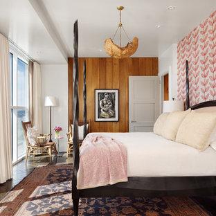 Example of a 1960s master dark wood floor and brown floor bedroom design in Austin with multicolored walls