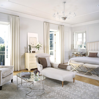 Example of a transitional bedroom design in Los Angeles with gray walls