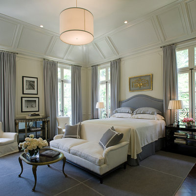 Example of a large classic master dark wood floor bedroom design in Atlanta with white walls and no fireplace