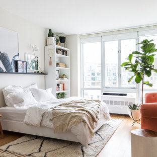 Bedroom - eclectic medium tone wood floor and brown floor bedroom idea in New York with white walls and no fireplace