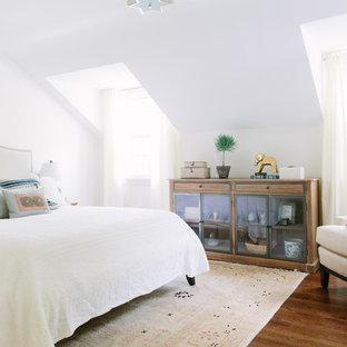 Bedroom - coastal master medium tone wood floor bedroom idea in Chicago with white walls