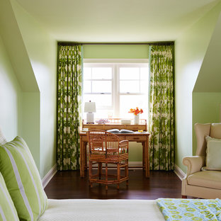 Inspiration for a large tropical guest dark wood floor and brown floor bedroom remodel in Jacksonville with green walls