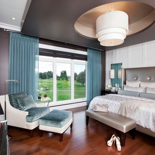 Inspiration for a contemporary dark wood floor bedroom remodel in Other with gray walls