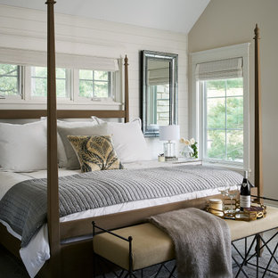 Inspiration for a transitional master bedroom in Chicago with white walls, vaulted and planked wall panelling.