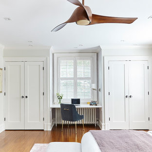 Design ideas for a large transitional master bedroom in Wilmington with beige walls, medium hardwood floors and brown floor.