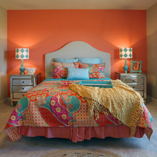 Mid-sized transitional guest bedroom in Other with orange walls, carpet and brown floor.
