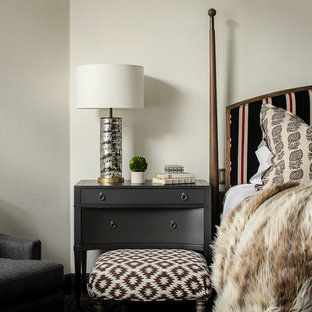 Example of a mountain style master bedroom design in New York with beige walls