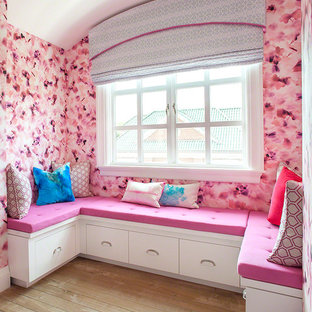 Design ideas for a large contemporary guest bedroom in New York with pink walls, light hardwood floors and no fireplace.