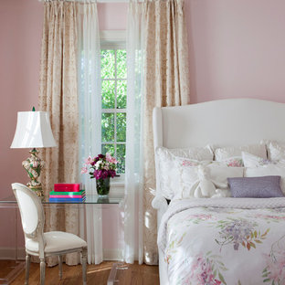 Bedroom - mid-sized traditional guest medium tone wood floor bedroom idea in Los Angeles with pink walls