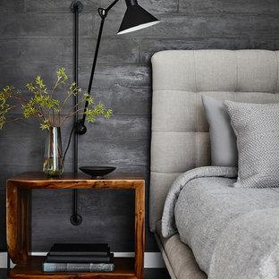 Idées déco pour une chambre contemporaine avec un mur gris, un sol en bois foncé et un sol noir.