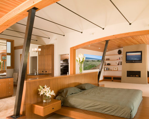 Example Of A Trendy Bedroom Design In Seattle With A Ribbon Fireplace