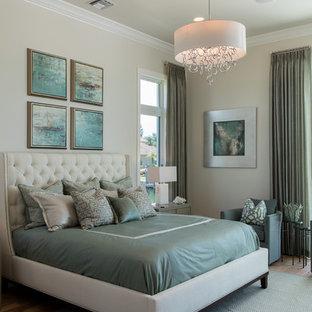 Large coastal master light wood floor bedroom photo in Miami with beige walls