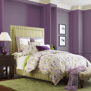 Photo of a mid-sized modern master bedroom in Boston with purple walls, dark hardwood floors, no fireplace and brown floor.