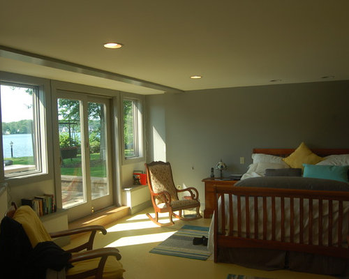 Example Of A Mid Sized Arts And Crafts Master Concrete Floor Bedroom Design  In New