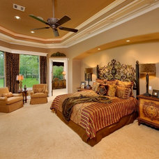Mediterranean Bedroom by Gary Keith Jackson Design Inc