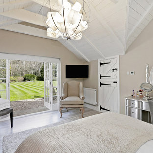 Rural bedroom in Hertfordshire with beige walls, no fireplace and grey floors.