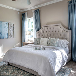 Transitional carpeted and beige floor bedroom photo in Orlando with beige walls