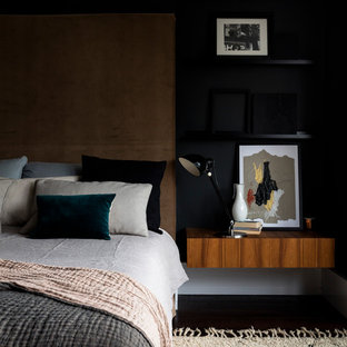 Photo of a medium sized contemporary master bedroom in London with black walls.