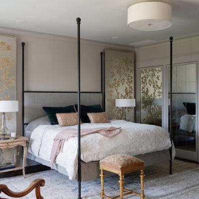 Inspiration for a large mediterranean master dark wood floor and gray floor bedroom remodel in Austin with beige walls