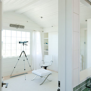 Inspiration for a small beach style guest light wood floor bedroom remodel in Boston with white walls