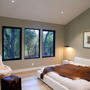 Example of a mid-sized trendy guest light wood floor and beige floor bedroom design in San Francisco with beige walls