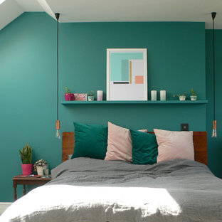 Photo of a contemporary bedroom in London with green walls.