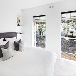 Design ideas for a mid-sized contemporary master bedroom in Sydney with white walls, carpet and white floor.