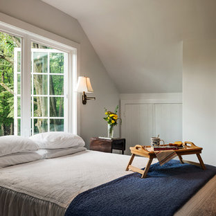 Bedroom - traditional medium tone wood floor bedroom idea in New York with white walls and no fireplace