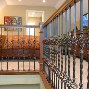 Wrought Iron Railing Adds Flair to Second Floor Bedroom