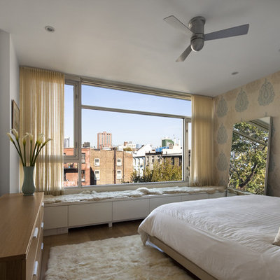 Bedroom - contemporary master bedroom idea in New York with multicolored walls