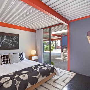 Photo of a midcentury master bedroom in San Francisco with grey walls, no fireplace and black floors.