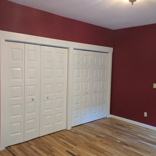 Bedroom - mid-sized craftsman master medium tone wood floor bedroom idea in Portland with red walls and no fireplace