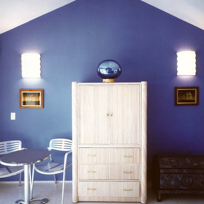 Example of an island style bedroom design in Other with blue walls