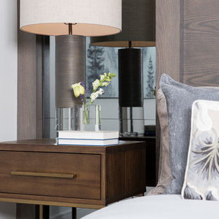 Inspiration for a large contemporary master dark wood floor and brown floor bedroom remodel in Vancouver with white walls and no fireplace