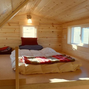 Inspiration for a small traditional loft-style bedroom in Portland with no fireplace.