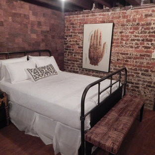 Photo of a large eclectic guest bedroom in Other with brown walls and vinyl floors.