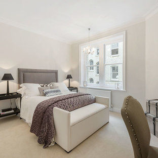 Classic bedroom in London with grey walls and carpet.