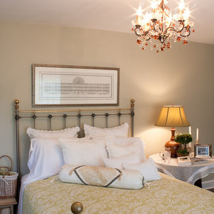 Example of a classic bedroom design in Boston with beige walls