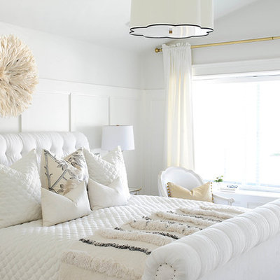 Transitional master carpeted bedroom photo in Vancouver with white walls