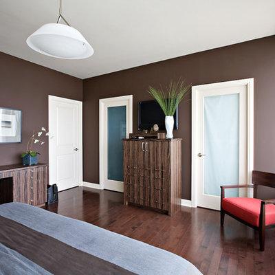 Bedroom - traditional dark wood floor and brown floor bedroom idea in Toronto with brown walls