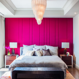 Inspiration for a transitional master bedroom in Toronto with pink walls and dark hardwood floors.