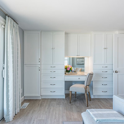 Large beach style master light wood floor and beige floor bedroom photo in Boston with gray walls and no fireplace